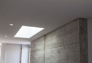 Shadow lining wall plastering around concrete feature wall